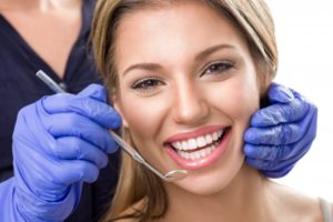 woman happy dental visit