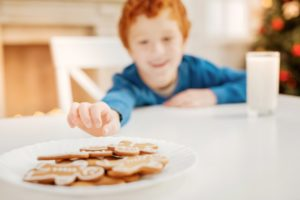 red head boy reaching for cookie